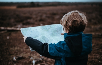 Child looking at a map